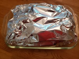 Baked Cabbage and Onions wrapped in foil ready to bake