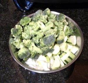 cut up vegetables in a silver bowl