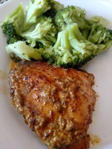 Coconut Buttermilk Southwestern Chicken next to broccoli on a white plate