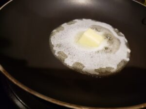butter melting in frying pan