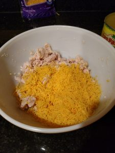 chicken and cheeses in bowl