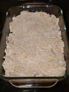 chicken and cheeses mixed in casserole dish