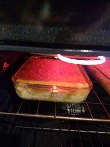 Chicken Enchilada Casserole in oven