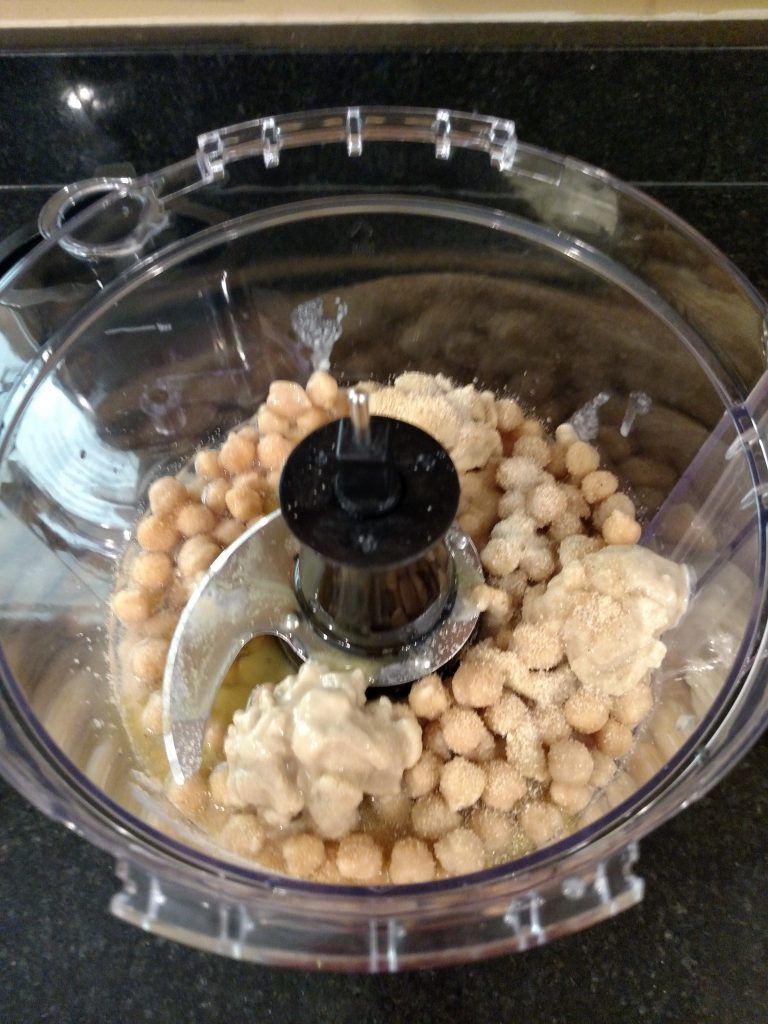 Basic Homemade Hummus ingredients in food processor before being processed