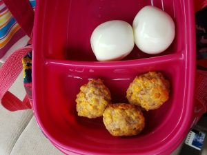 3 Low Carb Gluten Free Sausage Balls and 2 hard boiled eggs in to-go container