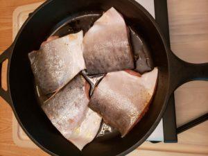 Blackened Salmon raw in skillet