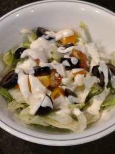 salad in bowl with ranch dressing