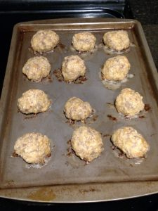 ingredients for Low Carb Gluten Free Sausage Balls nicely browned on baking sheets