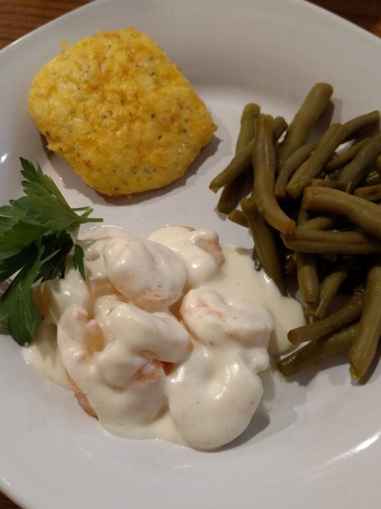 Low Carb Garlic Cheese Biscuits on plate with green beans and shrimp covered with alfredo sauce
