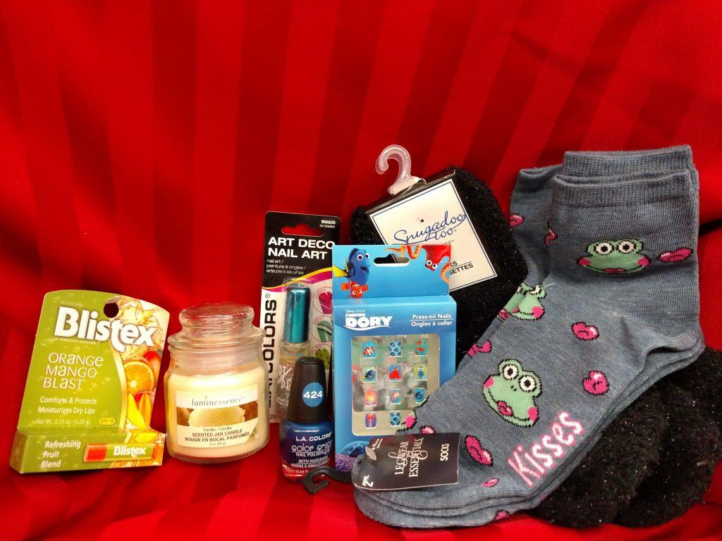 socks, fake nails, nail polish, candle, lip moisturizer