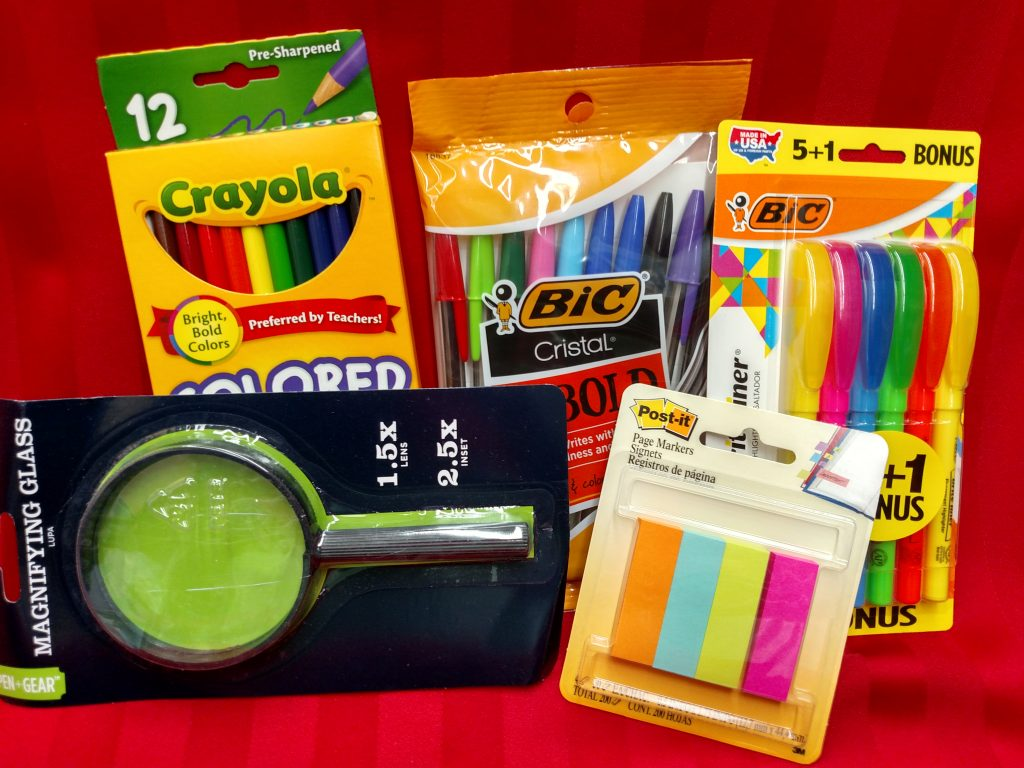 school supplies and magnifying glass
