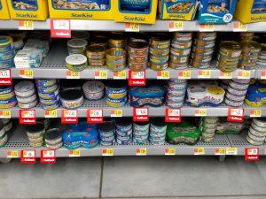 store shelf of canned tuna