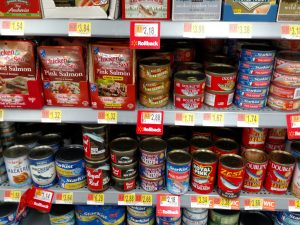 store shelf of canned fish