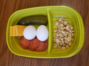 Pepperoni, cheese, pickle, hard boiled eggs and macadamia nuts