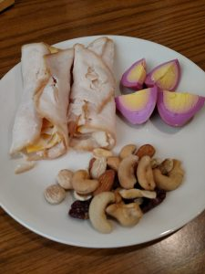 Lunchmeat and cheese roll ups, mixed nuts and red beet egg