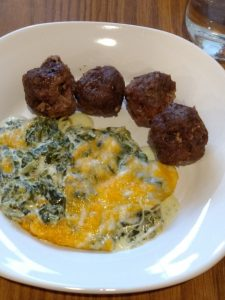 3 Ingredient Keto Crock Pot Meatballs and Creamy spinach cheese bake on white plate