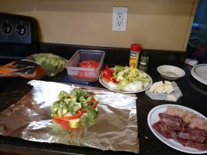 ingredients for Keto Meat and Vegetable Foil Packets set out on counter