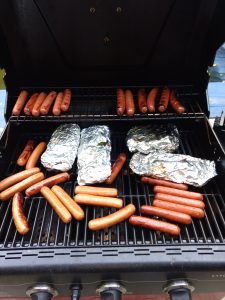 Keto Meat and Vegetable Foil Packets on grill with hot dogs