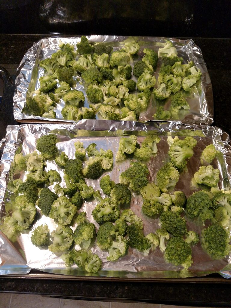 broccoli on foil covered baking sheet