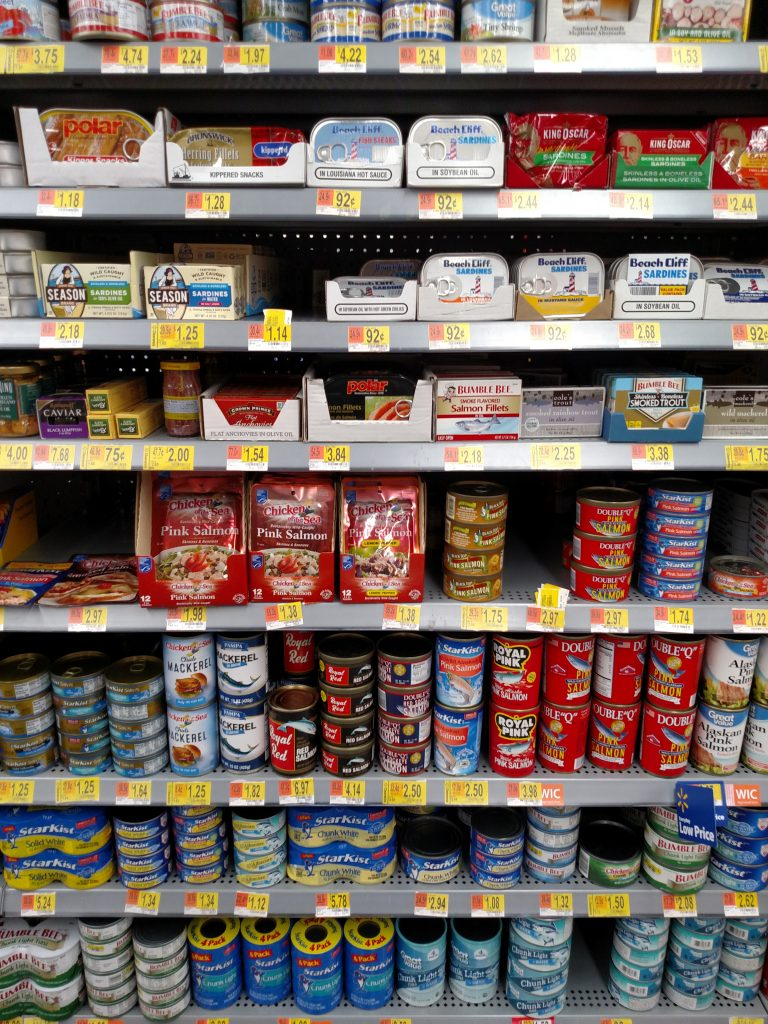 tuna and other canned meats on store shelves