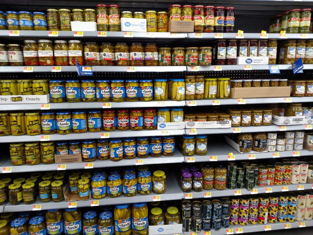 pickles and olives on store shelves