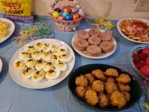 deviled eggs, sausage balls and cinnamon muffins on Easter buffet
