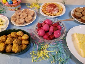 red beet eggs, sausage balls, cinnamon muffins and cheese ball and crackers on Easter buffet