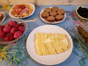cheese danish, cinnamon muffins, cheese ball and red beet eggs on Easter buffet