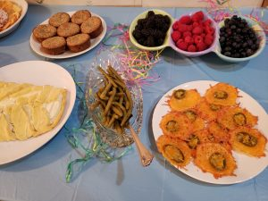 cheese crisps, pickled green beans, berries, cinnamon muffins and danish on Easter buffet
