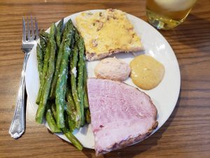 Keto Spicy Sweet Mustard on a dinner plate with ham, asparagus and twice baked cauliflower