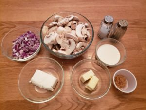 ingredients for Creamed Mushrooms in individual bowls