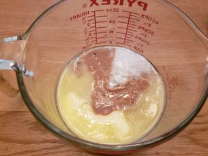 peanut butter and butter melted in measuring bowl