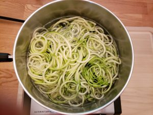 zoodles in saucepan with water