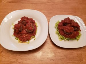 2 plates of Keto Zoodles with Meatballs and Marinara Sauce before cheese is added