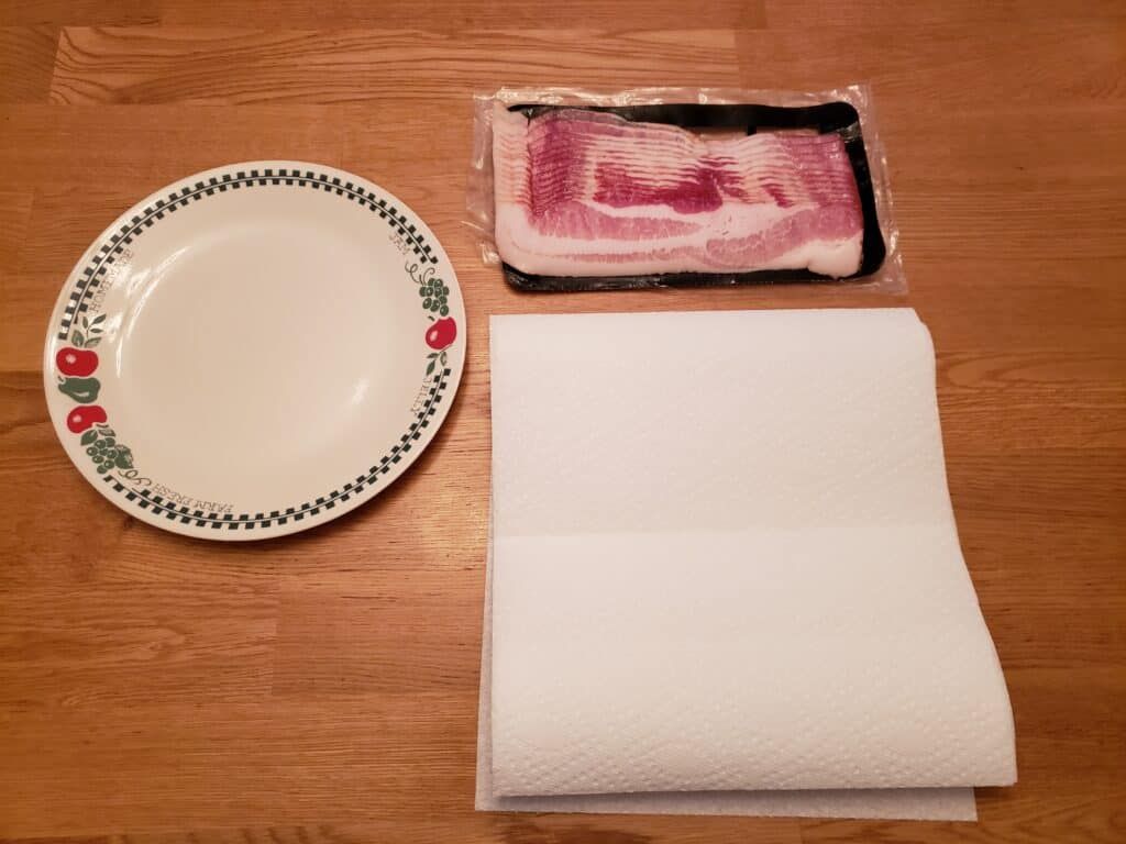 package of bacon, plate, paper towels