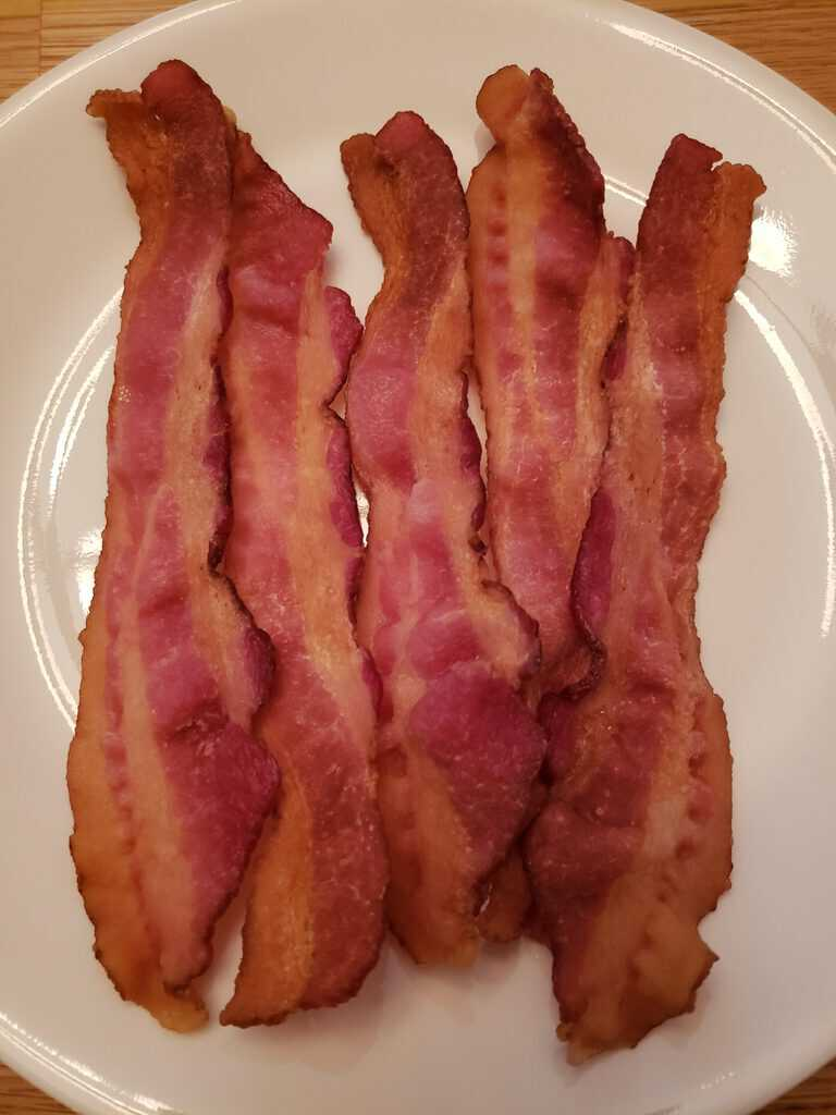 5 slices of bacon on white plate