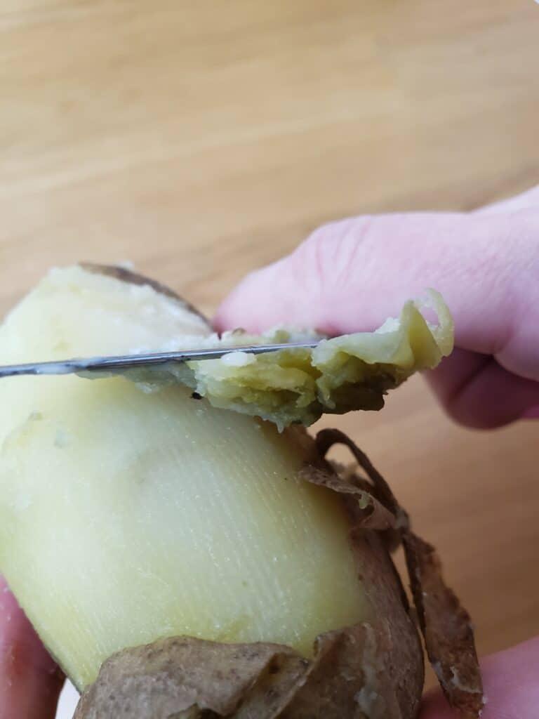 peeling cooked potatoes