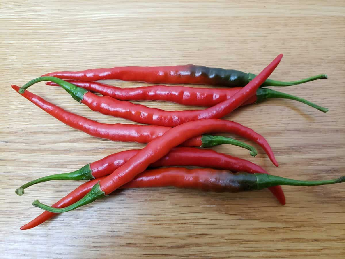 7 cayenne peppers on table
